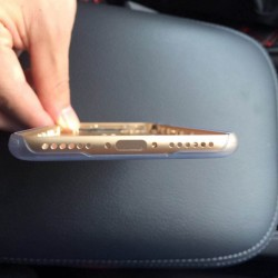 The underside of the iPhone 7 shows no 3.5mm jack, a second speaker instead