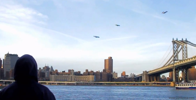 An onlooker watches the three mysterious figures fly around New York