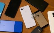 Google Pixel 3 lite photographed next to original Pixel, several iPhones