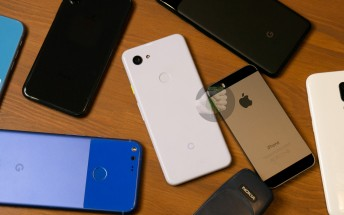 Google Pixel 3 lite photographed next to original Pixel, several iPhones